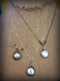 Coin pearl and silver pendant necklaces, $89-$110 at Quirks of Art, in The Shops at High Street, Williamsburg, VA.