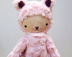 A baby pink teddy with pretty purple ear flowers. Made with ultra soft textured minky fur.  Ready to ship!  Stands about 15 inches tall.