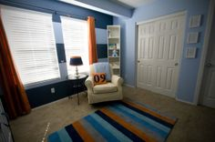 "My nursery colors! No rug though.    Using for the blues-  Dark blue: 4005-6C ""Mountain River""  Light blue: 4005-5C ""Coventry Blue""  Lowes ""Valspar"" Satin Finish"