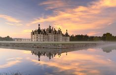 Fit for a fairy tale: The mesmerizing Chateau Chambord in the Loire Valley in France looks mystical at dawn