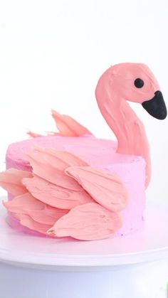 We've turned the trendy brushstroke cake into a flamingo made with buttercream frosting and chocolate melts.