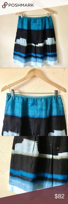 Nic + Zoe Deep Water Silk Blend Skirt This beautiful skirt is a gorgeous blend of azure, sky and cerulean blues with black, ochre and sand swaths mixed throughout. The whole effect brings to mind a midnight ocean. It is a perfect blend of cotton and silk...the best kind of silk blend and a stunner for the warming months! Shell is 56% cotton and 44% silk. Lining is 100% cotton. Cheers! NIC + ZOE Skirts Midi