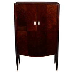 Fine Art Deco Two-Door Cabinet Jules Leleu(1883-1961) Mahogany with ivory inlay, sabots and escutcheons Sycamore interior POR