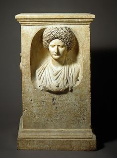 """Marble funerary altar of woman The Latin inscription identifies her, it says : """"To the spirits of the dead. Lucius Annius Festus, for the most saintly Cominia Tyche, his most chaste and loving wife, who lived 27 years, 11 months, and 28 days, and also for himself and for his descendants."""" The hairstyle of Cominia is typical for the Flavian Period. Roman Flavian or Trajanic Period, 90 – 100 A.D Source: The Metropolitan Museum"""