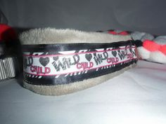 """It's impossible not to love this Wild Child ring lead with a tug braided into the lead!     Lead will fit from 12"""" to 20"""" neck (measure behind the ears for accuracy) with a 3-1/2' lead length.    18"""" four strand fleece tug (hot pink, black, white and grey) is tightly braided and will last through a solid bite and heavy tugger and retains some give for the game. (Silver/Grey neck piece)  26"""" long four strand (hot pink, light pink, black and white) fleece tug is a softer more pliable tug for…"""