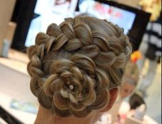 Wow! Fun way to braid your hair. Looks like a flower!