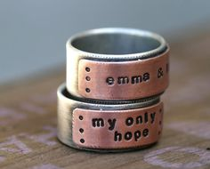 Two-tone sterling silver and copper stamped band ring. Personalize this mixed metal ring with a childs name, a favorite quote, an anniversary date or anything else you can think of. Please see our policies page for the turn around time on orders here... http://etsy.me/shoppolicies    The listing is for one ring that measures about 3/8 high. A thiner version of this ring is available here...  http://www.etsy.com/listing/73428411/copper-and-sterling-...