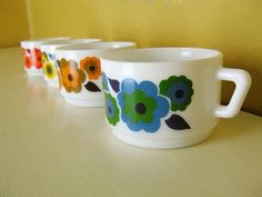 #pyrex #vintage kitchenware I've never seen these before.  flower pyrex cups  #lovely