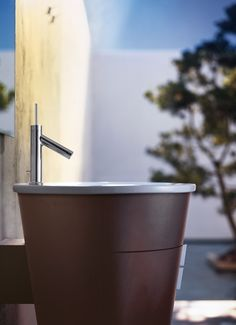 It's actually quite simple: faucet and cabinet appear like a small well or fountain.