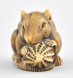 A Rat With Peanut Netsuke, Japanese , 05.22.10, Sold: $264.5