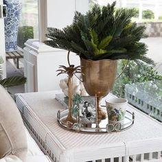 A tropical inspired coffee table vignette. #alfrescoemporium #islandemporium #bundall #collaroy #interiorinspiration #decorlove #bahamasstyle #tropicalstyle #islandlifestyle #islandinteriors #tropicalhouse #tropicalliving #rattanfurniture