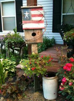 Rustic Patriotic Birdhouse...and old crock in the garden.