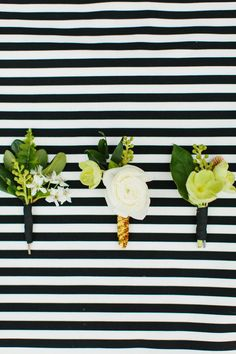 Classic black and white awning stripes provide the perfect backdrop. #whbmwedding