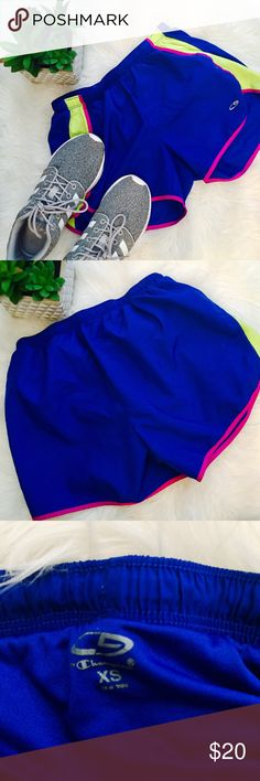 "Blue yellow and pink Workout shorts Good condition! Fit true to size - XS. Outer length-9"", inner length-10"", waist- about 11""/12"" hips-15"", 100% polyester Champion Shorts"