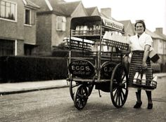 A woman delivers milk with her gas mask - UK - 7 July 1939