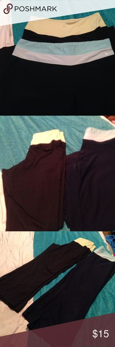 NIKE AND FILA CROPPED YOGA PANTS This is for 2 pair cropped yoga pants. Nike pair band is light blue and white. and the pants are a very dark blue. The Fila pair has a yellow/green band with the pants portion being black. Both are fitdry material. Nike/Fila Pants Track Pants & Joggers