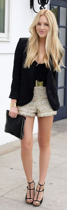 Chic outfit. Black blazer and glitter shorts, paired with metallic belt, simple black heels and a black studded clutch.
