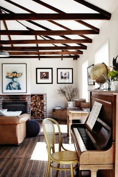 Amazing home...exposed beams, fire place, upright piano, globe, the list goes on