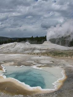 Heart Spring and Lion Geyser erupting in the background, Yellowstone