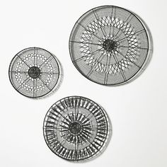 Resembling abstract representations of the cosmos known as mandalas, these lacy rounds are meticulously handwoven of iron wire in delicate, mesmerizing patterns. Choose from three sizes, each with its own unique pattern, or hang all three as a striking wall accent.<br /><br /><NEWTAG/><ul><li>Handcrafted</li><li>Iron wire with antique zinc finish</li><li>For indoor display only</li><li>Keyhole hanger</li><li>Avoid exposure to moisture</li><li>Dust with soft dry cloth</li><li>Made in…