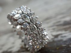 perfect utilization of marquise shaped diamonds flanked by rounds perfectly nooked in the taper of the marquise.  approx 4ct