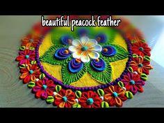 janamastmi rangoli with peacock feather n beautiful flowers/janamastmi rangoli with flowers/satisfying art by jyoti Rathod this rangoli made by using spoon, .