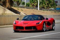 The open-top version of Ferrari [NYSE:RACE] LaFerrari flagship makes its world debut on September 29 at the 2016 Paris auto show but photos of the car have already been released and now it's been spotted in the wild. The car will have a new name, confirmed in these shots from Ferrari...