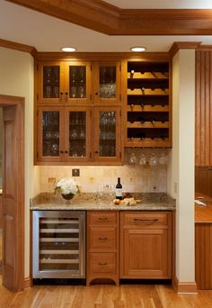 Wet bar idea the wine bottle holder and the stemware slots, for living room wet bar.