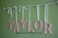 Name Wall Hanging - The Idea Room:  I think those would look super cute in the kids room, with their names and possibly different colors, of course.