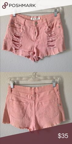 MinkPink High Waisted Distressed Shorts These shorts are so feminine and perfect for summer! Perfect distressing, and fit! Great condition! Not from Urban. Tag says size Small, but would fit a 26 best. No returns, please ask all questions before purchasing! Urban Outfitters Shorts Jean Shorts