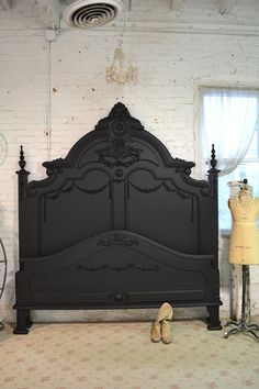 Wow what an amazing headboard for your romantic boudoir. FEATURES: Super dramatic high headboard with lots of detail and carvings. Complete with footboard, beautiful side rails and slats. SHOWN IN KING ALSO AVAILABLE IN QUEEN FINISH: Painted with our shabby French black and distressed just right. MEASURES: 66L X 89 H This is a brand new piece that can be painted any color you like. If you are working with specific colors on your bedding or walls just convo us and we can paint any of our p...