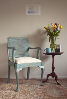 Jacqueline - Refinished furniture  by Lucille. Painted cane backed chair, reupholstered seat in linen, distressed shabby chic look