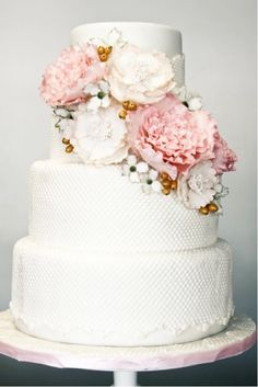 textured wedding cake with light colored flowers