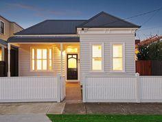 White on white Edwardian house. Like the black front door