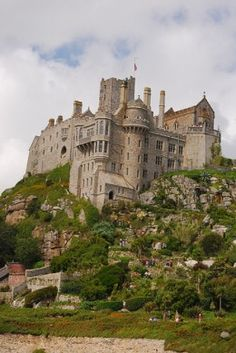 St. Michaels Mount Castle, Cornwall, UK- I went here on my Honeymoon - it was amazing to say the least - Bring your walking shoes!!