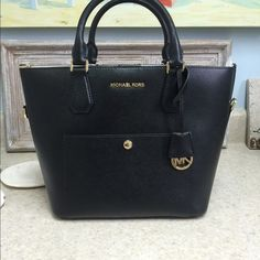Michael Kors bag NEW with tags! New with tags. Black in color and also has shoulder strap! Michael Kors Bags Shoulder Bags