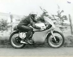 Geoff Duke at the Ulster Grand Prix. Late 50's. Very fast, neat and smooth.