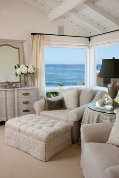 I love the cozy nook with the muted colors, and how the ocean/nature is the vibrant accent color. I also love the use of antiques pieces