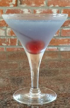 AVIATION. Mix in a shaker with ice: Gin (2 1/8 oz), Lemon Juice (1/2 oz), Maraschino Liqueur (1/2 oz), Creme de Violette (1/2 oz). Shake and strain into chilled cocktail glass, add a cherry. Blue skies for the aviator!