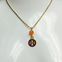 """Tory Burch Gold Tone Orange Beaded Logo Necklace GORGEOUS! Long Gold Tone Orange Facetted Beaded Logo Pendant Necklace. 32"""" Length- RETAIL $125 Tory Burch Jewelry Necklaces"""