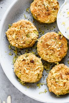 Crispy Baked Lemon Chickpea Cakes - Cooking for Keeps #Chickpea #garbanzobeans #garbanzos #chickpeas #cook #dinner #vegan #veganrecipes #veganfood #healthylifestyle #healthy #healthyfood #nutrition Chickpea Cakes, Chickpea Fritters, Cooking Garbanzo Beans, Cheese Whiz, Broccoli Cheddar, Plain Greek Yogurt, Lemon, A Food