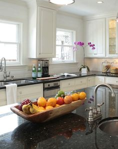Countertop Fruit Storage | For a long or large island, arrange colorful fruit in long vessel ...
