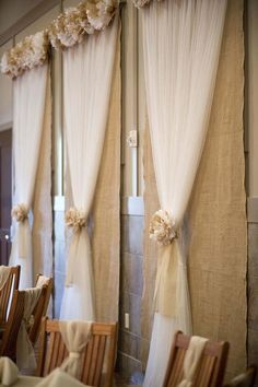 Burlap tulle wedding back drop.. something along this line, but with white light