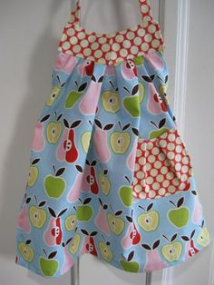 I have this fabric & this apron pattern.  Guess it's time to dig it out and sew one up.