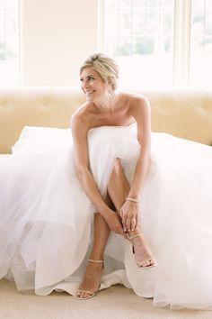 Classic black tie bride: Photography : Love & light - http://www.loveandlightphotographs.com/   http://www.stylemepretty.com/new-jersey-weddings/gladstone-new-jersey/2016/02/29/classic-black-tie-wedding-with-pretty-pink-peonies/