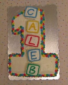 Caleb's First Birthday Cake!  3-D cake blocks spelled out his name on the top