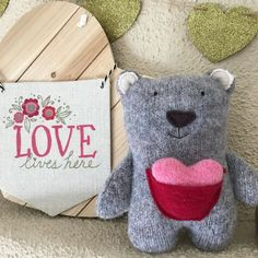Ben is a one of a kind plush bear made from upcycled wool. He has a pocket on his front and comes with a wool heart. #ecofriendlytoy #plushbear #valentinesday #kids #family #upcycled #wool #hearts #handmade #gifts