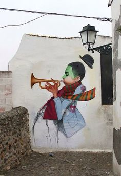 Trumpet musician Street art unknown place and artist