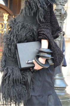 Details - All Black and Furry, Paris Fashion Week FW 2014   #fashiondetails #allblack #lilygatins #fur #leather #bracelets #fingercuffs #clutch #PFW #parisfashionweek #FW2014 #AW2014