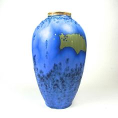 A Valdemar Englehardt for Royal Copenhagen crystalline glazed porcelain vase, circa 1894 - 1900. A Valdemar Englehardt for Royal Copenhagen crystalline glazed porcelain vase, circa 1894 - 1900. Of ovoid form, the exterior with a blue crystalline glaze to both the lower and upper section of the vase dispersed with pale lime green abstract decoration to the body. Marked with the green Royal Copenhagen stamp, three wavy blue lines, artist's monogram initials VE and E830 to the base. 8.5 in ...